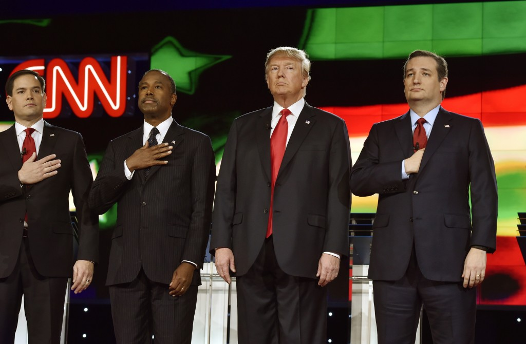Republican U.S. presidential candidates (L-R) Senator Marco Rubio, Dr. Ben Carson, businessman Donald Trump, and Senator Ted Cruz stand onstage together during the singing of the U.S. national anthem the Republican presidential debate in Las Vegas, Nevada this week. Photo By David Becker/Reuters