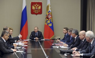 Russian President Vladimir Putin (C) chairs a meeting with members of the Security Council at the Novo-Ogaryovo state residence outside Moscow, Russia, December 18, 2015. REUTERS/Michael Klimentyev/Sputnik/Kremlin ATTENTION EDITORS - THIS IMAGE HAS BEEN SUPPLIED BY A THIRD PARTY. IT IS DISTRIBUTED, EXACTLY AS RECEIVED BY REUTERS, AS A SERVICE TO CLIENTS. - RTX1Z8SX