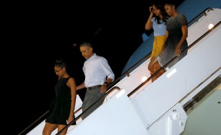 U.S. President Barack Obama (2nd L), first lady Michelle Obama (R) and their daughters Sasha (L) and Malia (2nd R) arrive via Air Force One at Joint Base Pearl Harbor-Hickam in Honolulu, Hawaii December 19, 2015.  Photo by Jonathan Ernst/Reuters.