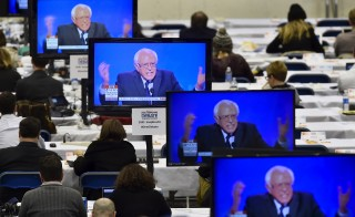 U.S. Democratic presidential candidate Bernie Sanders appears on television screens in the media work-room during the Democratic presidential candidates debate at Saint Anselm College in Manchester, New Hampshire December 19, 2015.      REUTERS/Gretchen Ertl      TPX IMAGES OF THE DAY      - RTX1ZF8F