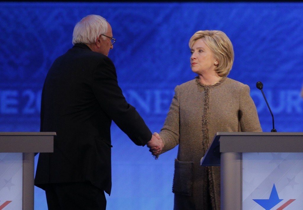 Democratic U.S. presidential candidate Senator Bernie Sanders shakes hands with rival Hillary Clinton at the conclusion of the Democratic presidential candidates debate at St. Anselm College in Manchester, New Hampshire December 19, 2015.  Photo by Brian Snyder/Reuters.
