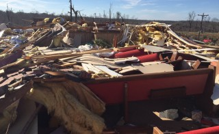 The remains of the Beverly Chapel CME Church on old Highway 4 are seen after a tornado struck Holly Springs, Mississippi, in this National Weather Service picture taken December 24, 2015.  Southern U.S. states began digging out on Thursday after severe storms including some 20 tornados killed at least 10 people and Mississippi delared a state of emergency.  REUTERS/National Weather Service Memphis/Handout via Reuters THIS IMAGE HAS BEEN SUPPLIED BY A THIRD PARTY. IT IS DISTRIBUTED, EXACTLY AS RECEIVED BY REUTERS, AS A SERVICE TO CLIENTS. FOR EDITORIAL USE ONLY. NOT FOR SALE FOR MARKETING OR ADVERTISING CAMPAIGNS - RTX2009L