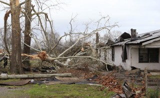 Damage caused by a tornado is seen in a neighborhood in Birmingham, Alabama, Saturday.  Photo By Marvin Gentry/Reuters