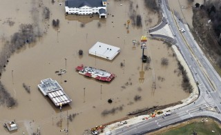 Submerged roads and houses are seen after several days of heavy rain led to flooding, in an aerial view over Union, Missouri, on Dec. 29, 2015. The high waters have been blamed for more than 20 deaths in Missouri and Illinois. Photo by Kate Munsch/Reuters