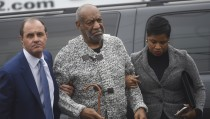 Actor and comedian Bill Cosby (C) arrives with attorney Monique Pressley (R) for his arraignment on sexual assault charges at the Montgomery County Courthouse in Elkins Park, Pennsylvania on Dec. 30, 2015. George Washington University announced Monday that it was rescinding an honorary doctoral degree that was given to Cosby in the 1990s. Photo by Mark Makela