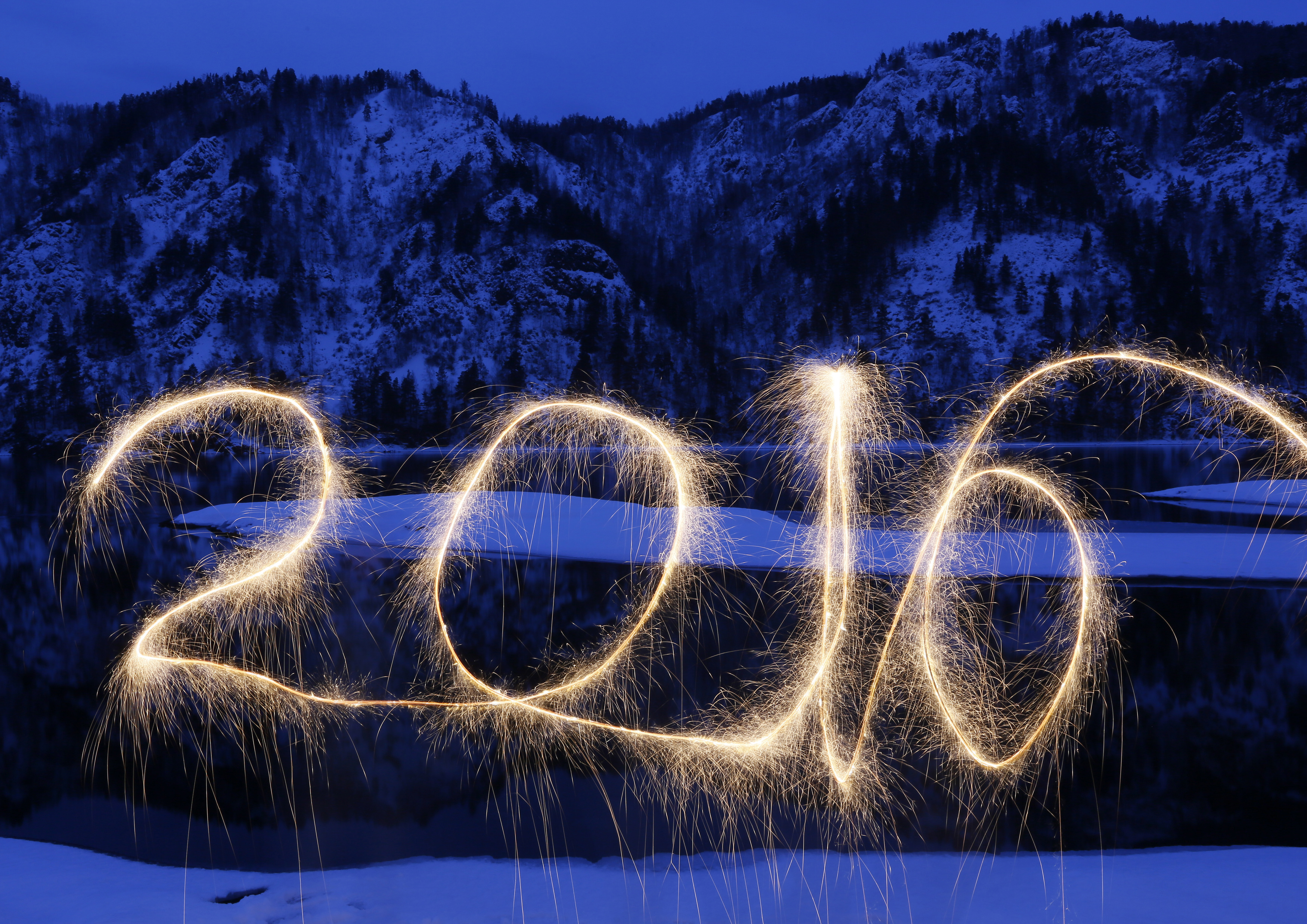 "The numbers ""2016"" are written in the air with a sparkler on a bank of the Yenisei River in the Taiga district, near the town of Divnogorsk outside Siberian city of Krasnoyarsk, Russia. Picture taken with long exposure. Photo by Ilya Naymushin/Reuters"
