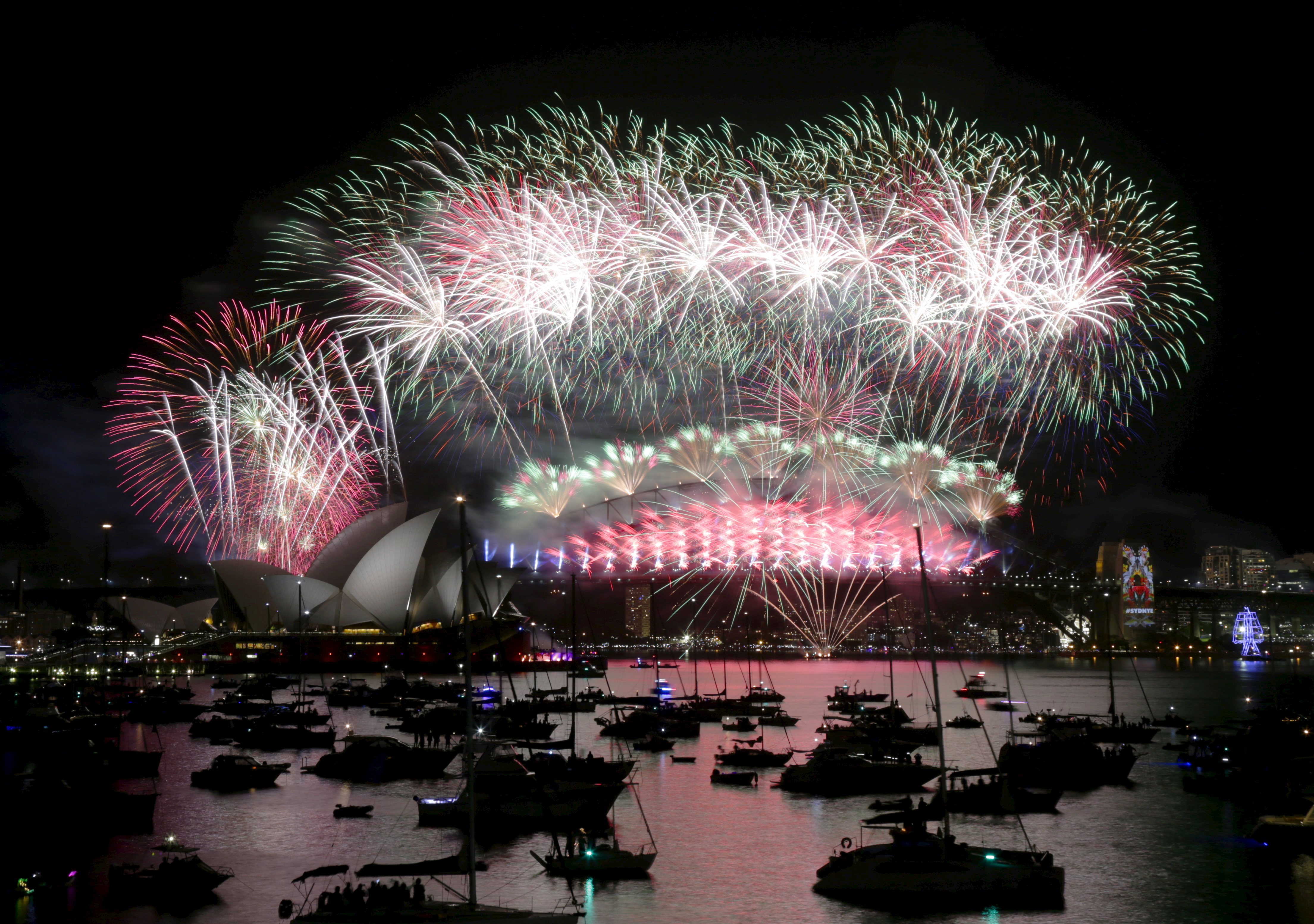Fireworks explode over the Sydney Opera House and Harbour Bridge as Australia's largest city ushers in the new year. Photo by Jason Reed/Reuters