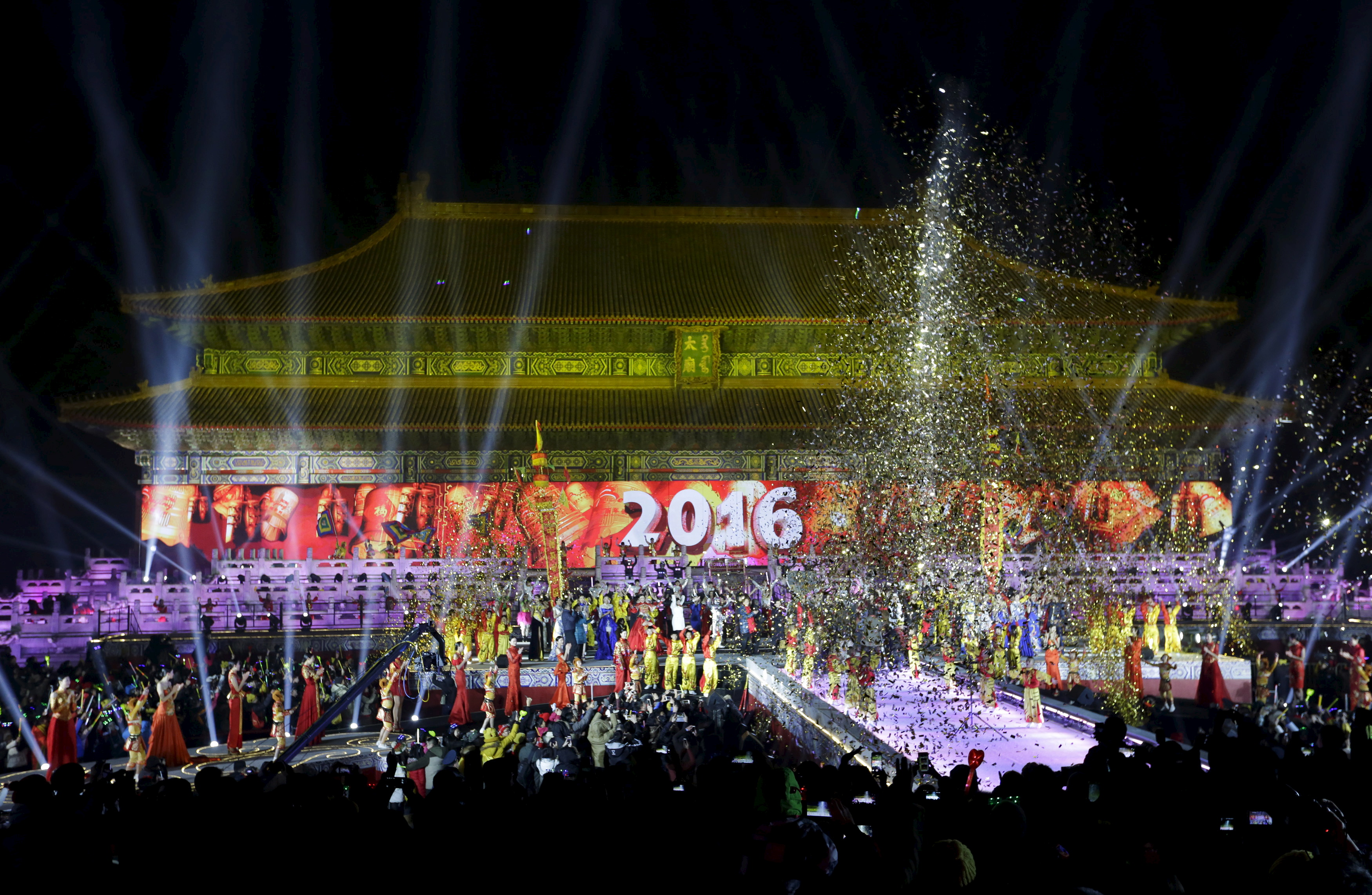 Dancers perform to celebrate the new year during a countdown event at Tai Miao, the imperial ancestral temple in the Forbidden City, in Beijing, China. Photo by Jason Lee/Reuters