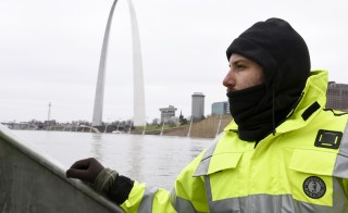 U.S. Geological Survey (USGS) hydro technician Jason Carron assesses the Mississippi River flood waters in St. Louis, Missouri December 31, 2015.  Missouri and Illinois were bracing for more flooding on Thursday as rain-swollen rivers, some at record heights, overflowed their banks, washing out hundreds of structures and leaving thousands of people displaced from their homes.  REUTERS/Kate Munsch - RTX20O4V