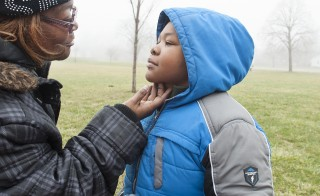 Siretha Lattimore visits her son Malik Cole, 9, at a park in Detroit.  Due to homelessness and Malik's asthma,  Lattimore put him and his siblings in foster care. Photo by Daniel Mears/The Detroit News