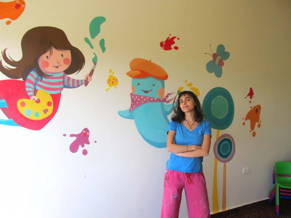 Brisly stands next to her work in Shtura, Lebanon. Photo courtesy of Diala Brisly