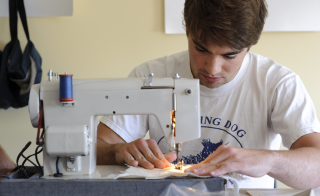 Middlebury's entrepreneurship programs create opportunities to bring creative ideas to life; for this student, designing his own backpacks led to a job at Patagonia. Photo courtesy of Middlebury College.