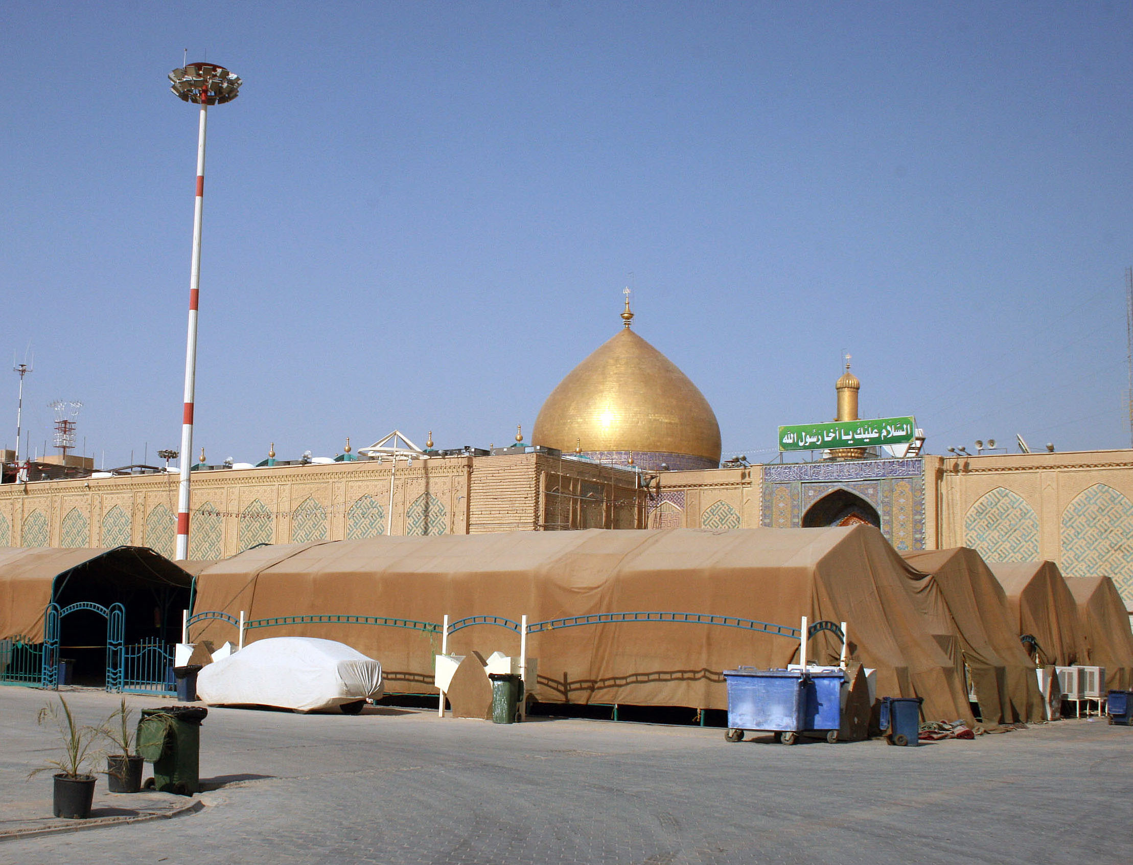 Pilgrims arrive by the busload to pray at the gold-domed shrine. Najaf Gov. Adnan Al-Zurufi told us 1.5 million visitors come each year, more than double the population of the city. Photo by Larisa Epatko