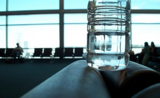 Water bottle airport. Travel. Photo by Flickr user Leo Newball, Jr.