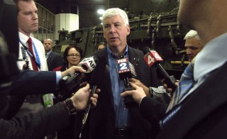 Michigan Gov. Rick Snyder talks to reporters Tuesday, during the press preview for the 2016 North American International Auto Show in Detroit, Michigan, Jan. 12, 2016. Snyder's chief of staff questioned in September whether the state was responsible for Flint's ongoing water crisis, emails released Wednesday showed. Photo by Paul Warner/Getty Images