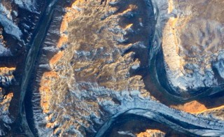 An astronaut captured this photograph of Utah's Green River doubling back on itself—a feature known as Bowknot Bend—from the International Space Station on Jan. 22, 2014. The bend looks like the letter 'A.' Photos provided by NASA