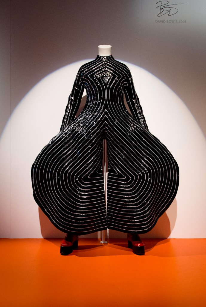 "The ""Tokyo-Pop"" bodysuit worn by musician and actor David Bowie on the ""Aladdin Sane"" tour is displayed at the ""David Bowie is"" exhibition at the Victoria and Albert (V&A) museum in central London on March 20, 2013. Running March 23 to August 11, the exhibition features more than 300 objects that include handwritten lyrics, original costumes, fashion, photography, film, music videos, set designs and Bowie's own instruments.  AFP PHOTO/Leon Neal        (Photo credit should read LEON NEAL/AFP/Getty Images)"