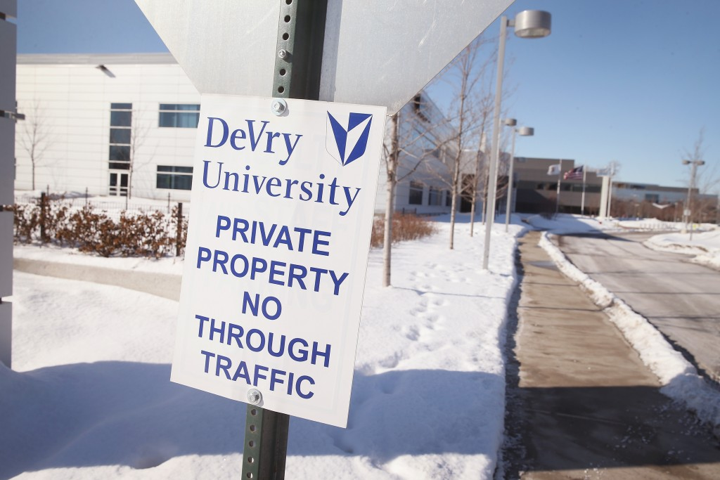 A sign identifies DeVry University's Chicago campus. Photo by Scott Olson/Getty Images