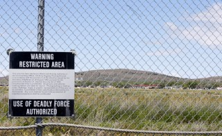 "A security fence with a deadly force warning sign, surrounds the main part of the Dugway Proving Ground on May 28, 2015 in Dugway, Utah. According to Pentagon report released Friday, the inadvertent shipment of live anthrax from a Dunway lab in Utah over several years was ""a serious breach of regulations,"" but said it did not pose a risk to public health. Photo by George Frey/Getty Images"