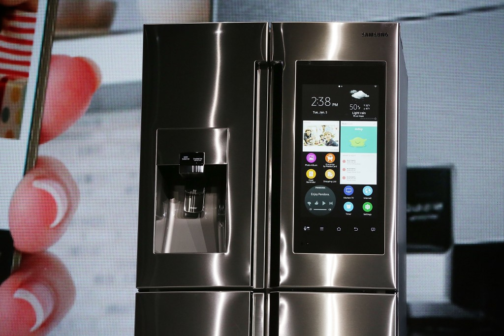 The Samsung Family Hub refrigerator, which is connected and features a 21.5 inch full HD LCD screen, with internal cameras to check what is left inside, and online grocery shopping through major credit cards, is introduced during a press event for CES 2016 at the Mandalay Bay Convention Center on January 5, 2016 in Las Vegas, Nevada. Photo by Alex Wong/Getty Images