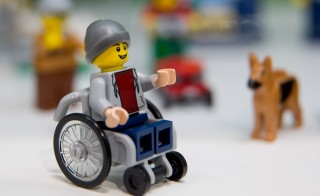 A Lego minifigure in a wheelchair is pictured at the Lego booth in Nuremberg, Germany during the 67th International Toy Fair. Photo by Daniel Karmann//AFP/Getty Images