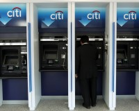 A man uses a Citibank automated teller machine at a branch in Washington January 19, 2010. Citigroup Inc posted a $7.6 billion quarterly loss on costs related to repayment of U.S. bailout funds and still-high loan losses, but the bank's shares edged higher as some investors saw glimmers of hope. REUTERS/Jim Young (UNITED STATES - Tags: BUSINESS) - RTR292W2