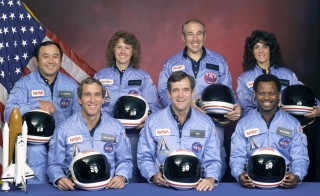 NASA's Space Shuttle Challenger (STS-51L) crewmembers are seen in this undated handout photo taken at Johnson Space Center in Houston, Texas in 1985.  Left to right: Mission Specialist Ellison S. Onizuka, Pilot Mike Smith, Teacher in Space Christa McAuliffe, Commander Dick Scobee, Payload Specialist Greg Jarvis, Mission Specialist Ron McNair and Mission Specialist Judy Resnik. Photo by NASA via Reuters