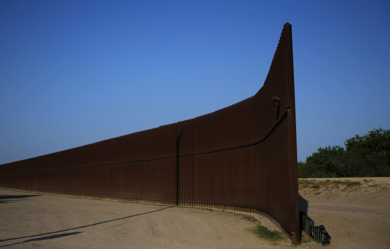 A break in the border fence at the United States-Mexico border is seen outside of Brownsville, Texas, in August 2014. Although New Hampshire is far from the U.S.-Mexican border, many voters in the early voting state have been pressing presidential candidates for more in-depth solutions to the country's immigration shortfalls. Photo by Shannon Stapleton/Reuters