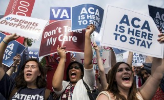 Supporters of the Affordable Care Act celebrate after the Supreme Court up held the law in the 6-3 vote at the Supreme Court in Washington June 25, 2015. The Supreme Court justices rejected an appeal Tuesday to President Barack Obama's health care law. Photo by Joshua Roberts/Reuters