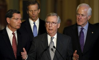 Senate Majority Leader Mitch McConnell (R-KY) (C) discusses the Syrian refugee crisis and the repercussions on those refugees after the killings in Paris in Washington Nov. 17, 2015. The Senate will consider new  screening procedures for Syrian and Iraqi refugees seeking entry to the United States. Photo By Gary Cameron/Reuters