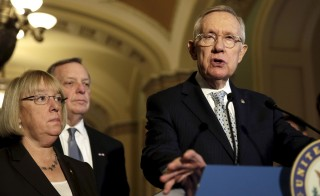 U.S. Senate Minority Leader Harry Reid (D-NV) (R) discusses the Syrian refuge crisis and the U.S. process repercussions on those refugees after the killings in Paris in Washington, D.C. on Nov. 17, 2015. Senate Democrats blocked a House bill Wednesday that added provisions to the U.S. vetting process for incoming refugees. Reid said Republicans didn't allow Democrats to offer amendments to the bill. Photo by Gary Cameron/Reuters