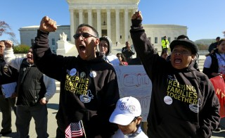 Immigrants and community leaders rally in front of the U.S. Supreme Court to mark the one-year anniversary of President Barack Obama's executive orders on immigration in Washington, Nov. 20, 2015. The Supreme Court agreed Tuesday to review Obama's plan that protect up to 5 million immigrants from deportation and allows them to work legally in the United States. Photo by Kevin Lamarque/Reuters