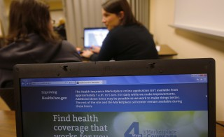 In this file photo, a self-employed student gets help from navigator in Portsmouth, New Hampshire. Millions of young adults healthy enough to think they don't need insurance face painful choices this year as the sign-up deadline approaches for President Barack Obama's health care law. Photo by Brian Snyder/Reuters