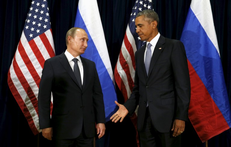 U.S. President Barack Obama extends his hand to Russian President Vladimir Putin during their meeting at the United Nations General Assembly in New York, Sept. 28, 2015. In a wide-ranging phone call Wednesday, Obama and Putin both called for a tough response to North Korea's latest nuclear claims, but left other matters, such as Ukraine and Syrian President Bashar Assad, unresolved. Photo by Kevin Lamarque/Reuters