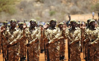 Kenya Wildlife Services (KWS) rangers take Oath of Allegiance during the passing out parade for 592 rangers at the Law Enforcement Academy Manyani in Tsavo West National Park, October 27, 2015. Kenya Wildlife Services Law Enforcement Academy conducts training programs for uniformed personnel including general security courses for staff from institutions outside the wildlife conservation fraternity especially to combat poaching, KWS officials said. Poaching has surged in the last few years across sub-Saharan Africa, where gangs kill elephants and rhinos to feed Asian demand for ivory and horns for use in folk medicines. Kenya has imposed stiffer penalties -- longer jail terms and bigger fines -- for wildlife poaching or trafficking, saying poaching is harming tourism, a major earner of foreign exchange. REUTERS/Thomas Mukoya - RTX1TIJK