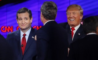 Republican U.S. presidential candidates (L-R) Senator Ted Cruz, former Governor Jeb Bush and businessman Donald Trump talk at the end of the Republican presidential debate in Las Vegas, Nevada December 15, 2015.    REUTERS/Mike Blake - RTX1YVKG
