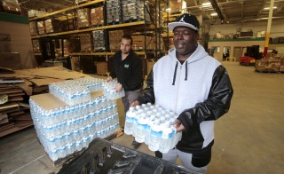 Anthony Fordham picks up bottled water from the Food Bank of Eastern Michigan to deliver to a school after elevated lead levels were found in the city's water in Flint, Michigan. Photo by Rebecca Cook/Reuters