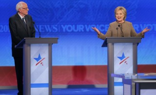 """U.S. presidential candidates Hillary Clinton and Sen. Bernie Sanders at the Democratic debate in Manchester, New Hampshire, on Dec. 19, 2015. Although President Barack Obama has said he wouldn't endorse a candidate in the primaries, in a Politico interview published Monday, he said his former secretary of state is """"wicked smart."""" Photo by Brian Snyder/Reuters"""