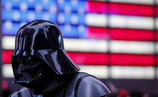 A man dressed as Darth Vader from Star Wars walks though Times Square in New York on Dec. 24, 2015. Photo by Carlo Allegri/Reuters