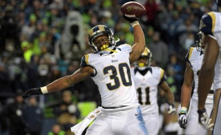 Dec 27, 2015; Seattle, WA, USA; St. Louis Rams running back Todd Gurley (30) spikes the ball after scoring on a 2-yard touchdown run in the fourth quarter against the Seattle Seahawks during an NFL football game at CenturyLink Field. Mandatory Credit: Kirby Lee-USA TODAY Sports - RTX207FV
