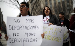 Immigrants and supporters rallied outside the White House in December to protest the Obama administration's series of raids to remove hundreds of undocumented families as early as January in the first such large-scale effort targeting the recent flood of border crossers. Photo by Carlos Barria/Reuters