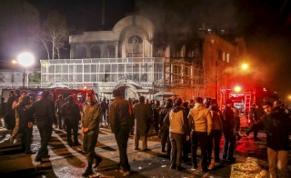 Smoke rises from Saudi Arabia's embassy during a demonstration in Tehran. Iranian protesters stormed the Saudi Embassy in Tehran early on Sunday morning. Photo by Mehdi Ghasemi/Reuters