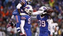 Jan 3, 2016; Orchard Park, NY, USA; Buffalo Bills outside linebacker Manny Lawson (91) celebrates his interception with defensive back Nickell Robey (37) and defensive back Mario Butler (39) during the second half against the New York Jets at Ralph Wilson Stadium. Bills beat the Jets 22 to 17.  Mandatory Credit: Timothy T. Ludwig-USA TODAY Sports - RTX20WG9
