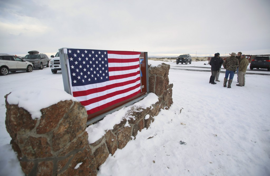 A U.S. flag covers a sign at the entrance of the Malheur National Wildlife Refuge near Burns, Oregon on Jan. 3. Photo by Jim Urquhart/Reuters