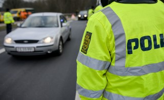 Danish Police officers check vehicles at the bordertown of Krusa, Denmark January 4, 2016. Denmark imposed temporary identity checks on its border with Germany on Monday following a similar move by Sweden, dealing a double blow to Europe's fraying passport-free Schengen area amid a record influx of migrants. REUTERS/Palle Peter Skov/Scanpix Denmark  ATTENTION EDITORS - THIS IMAGE WAS PROVIDED BY A THIRD PARTY. FOR EDITORIAL USE ONLY. NOT FOR SALE FOR MARKETING OR ADVERTISING CAMPAIGNS. THIS PICTURE IS DISTRIBUTED EXACTLY AS RECEIVED BY REUTERS, AS A SERVICE TO CLIENTS. DENMARK OUT. NO COMMERCIAL OR EDITORIAL SALES IN DENMARK. NO COMMERCIAL SALES. - RTX20YOT
