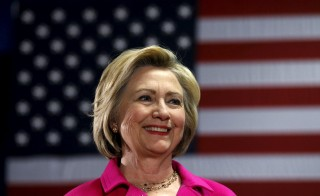 U.S. Democratic presidential candidate Hillary Clinton listens to her introduction at a campaign event in Davenport, Iowa on Jan. 4, 2016. Democratic presidential hopeful Hillary Clinton will unveil a new initiative Tuesday that aims to boost autism services and research for Americans affected by the development disorder. Photo by Jim Young/Reuters