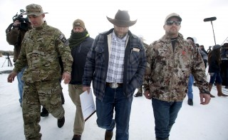 "Ammon Bundy departs after addressing the media at the Malheur National Wildlife Refuge near Burns, Oregon, January 4, 2016. The leaders of a group of self-styled militiamen who took over a U.S. wildlife refuge headquarters over the weekend said on Monday they had acted to protest the federal government's role in governing wild lands. Bundy, a leader of the group, told reporters outside the occupied facility on Monday that his group had named itself ""Citizens for Constitutional Freedom"" and was trying to restore individual rights. Bundy and law enforcement officials declined to say how many people were occupying the refuge headquarters. REUTERS/Jim Urquhart - RTX21110"