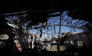 People gather at wedding hall after it was hit by a Saudi-led air strike in Yemen's capital Sanaa January 5, 2016. REUTERS/Khaled Abdullah - RTX2137X