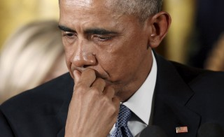 U.S. President Barack Obama reacts while talking about Newtown, Connecticut, and other mass killings during an event held to announce new gun control measures in Washington, D.C.,  Jan. 5, 2016. Photo by Kevin Lamarque/Reuters