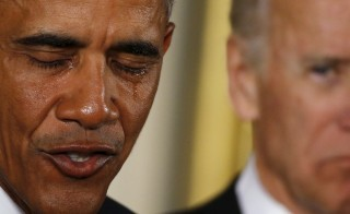 U.S. President Barack Obama is seen in tears while delivering a statement on steps the administration is taking to reduce gun violence in the East Room of the White House in Washington January 5, 2016. Vice President Joe Biden is at right. REUTERS/Carlos Barria  - RTX215LR